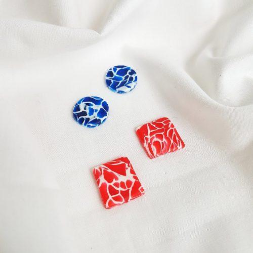 Pendientes crash rojo y azul